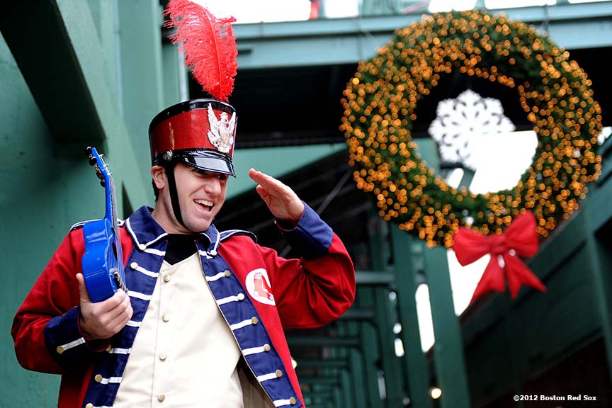 """Big League Brian, an entertainer on stilts, greets fans during the tenth annual Christmas at Fenway Park Saturday, December 1, 2012. The event featured player and alumni meet and greets, a Fenway Winter Village set up in the Big Concourse, access for fans to the home clubhouse and warning track, and an LED Winter Lights musical projected on the Green Monster. """