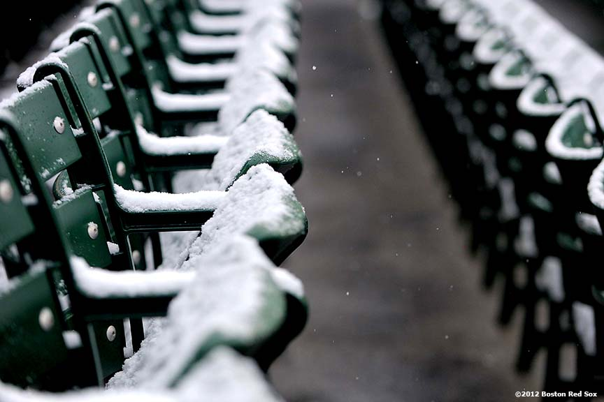 """Snow falls onto the outfield bleacher seats at Fenway Park in Boston, Massachusetts Saturday, December 1, 2012."""