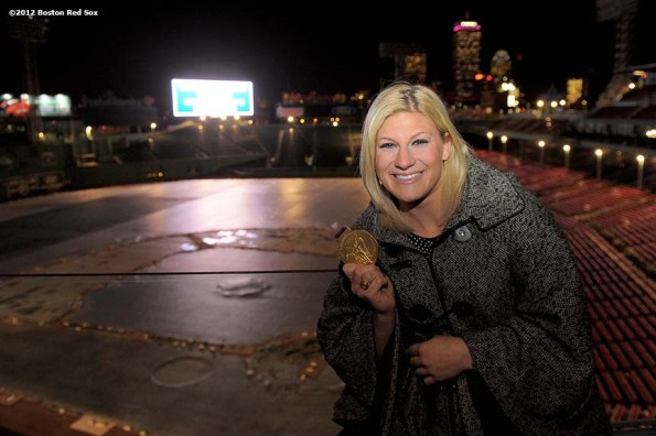 """2012 Olympic gold medal judo fighter, Kayla Harrison, poses with her gold medal in Fenway Park in Boston, Massachusetts Friday, December 14, 2012. Harrison was a guest speaker at the 2012 Boston Red Sox scholars holiday party."