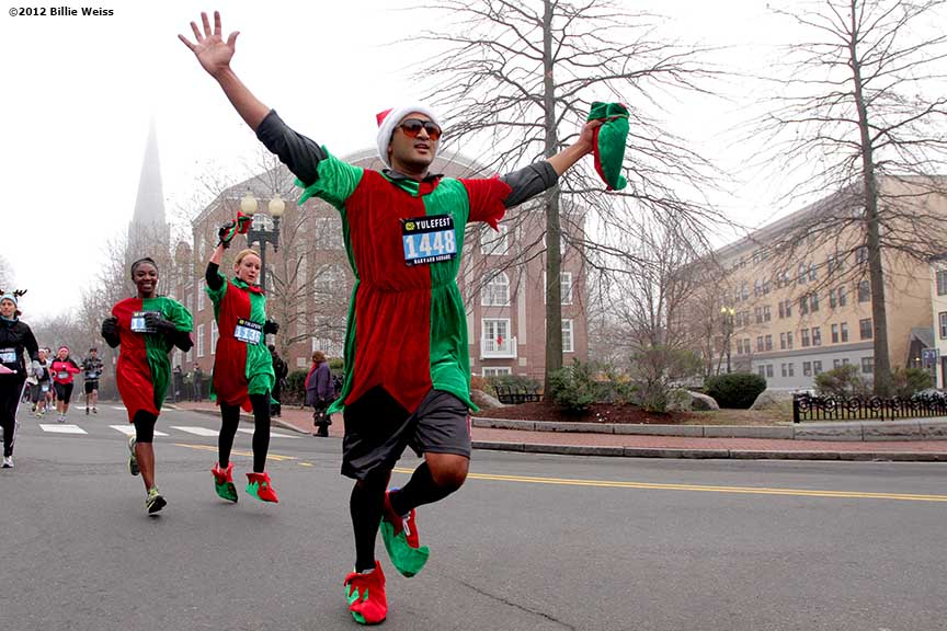 """A runner gestures as he races in Yulefest, a holiday themed 5K race in Cambridge, Massachusetts Sunday, December 2, 2012."""