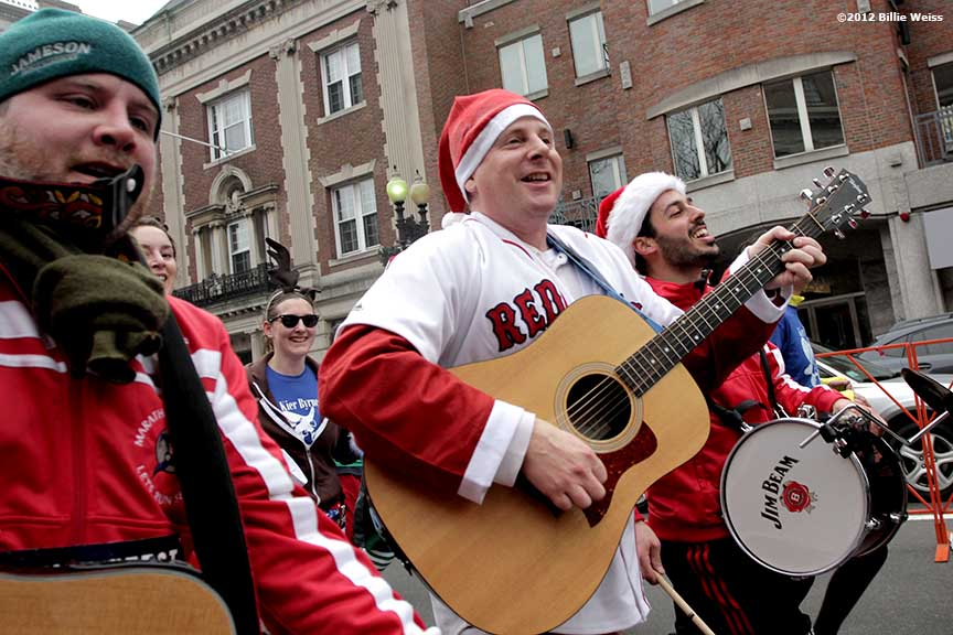 """Racers sign and play instruments as they run in Yulefest, a holiday themed 5K race in Cambridge, Massachusetts Sunday, December 2, 2012."""