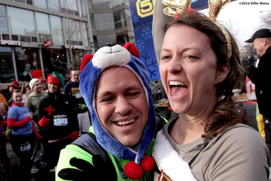 """Guests celebrate after winning a dance-off competition during Yulefest, a holiday themed 5K race in Cambridge, Massachusetts Sunday, December 2, 2012."""