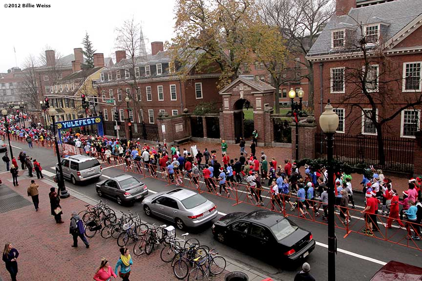 """Racers pass through the course start line during Yulefest, a holiday themed 5K race in Cambridge, Massachusetts Sunday, December 2, 2012."""