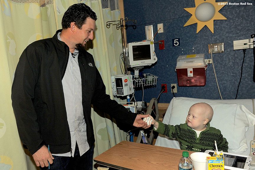 """Boston Red Sox closer Joel Hanrahan visits a patient in the Jimmy Fund clinic at the Dana Farber Cancer Institute in Boston, Massachusetts Wednesday, January 9, 2012. This was Hanrahan's first hospital visit as a member of the Boston Red Sox."""