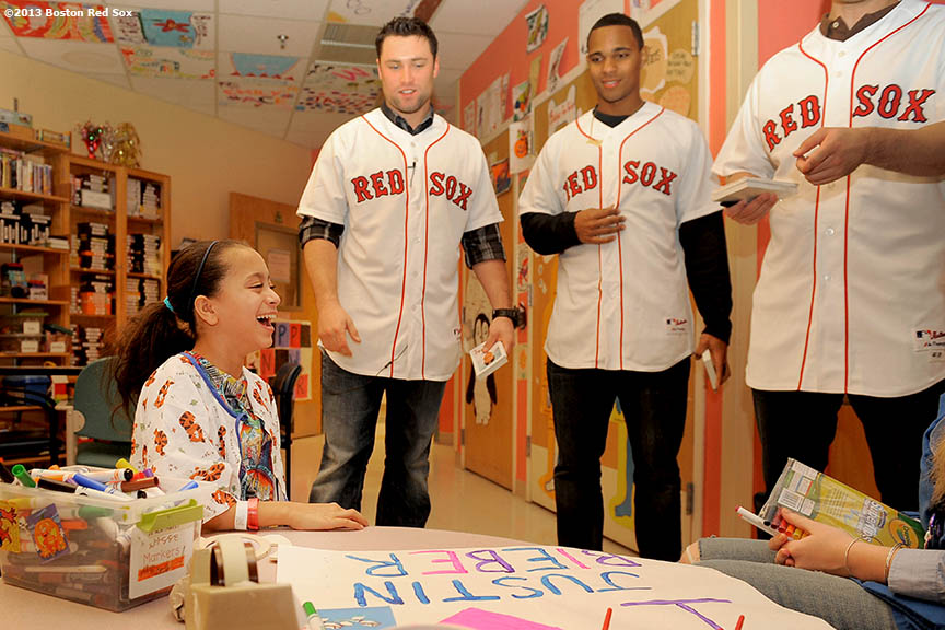 """Boston Red Sox rookies Bryce Bentz and Xander Bogaerts visit a patient in the Jimmy Fund clinic at the Dana Farber Cancer Institute in Boston, Massachusetts Wednesday, January 9, 2013. The group of top Red Sox prospects spent time in Boston this winter to get accustomed to the city and meet with Red Sox personnel."""