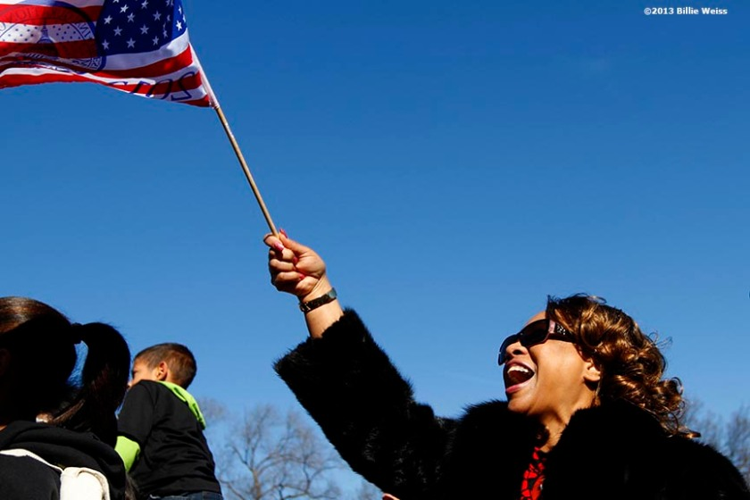 """A supporter reacts in front of the CNN news set on the National Mall in Washington, D.C. as she watches a telecast of the swearing-in of President Barack Obama Sunday, January 20, 2013."""