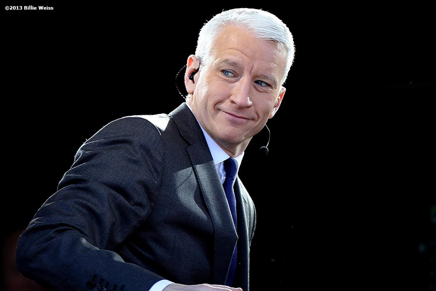 """Anderson Cooper, anchor of CNN's AC360, acknowledges spectators from atop the CNN press riser on the National Mall in Washington, D.C. on the day before the 57th Presidential Inauguration Sunday, January 20, 2013."""