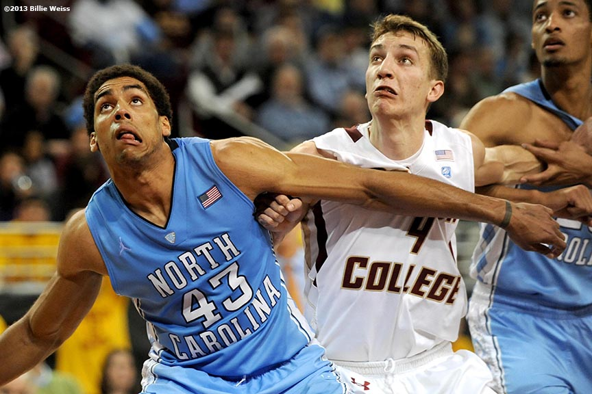 """""""North Carolina Tar Heels forward James McAdoo boxes out Boston College forward Eddie Odio during the second half of a men's basketball game at Conte Forum at Boston College in Chestnut Hill, Massachusetts Tuesday, January 29, 2013. North Carolina defeated Boston College 82-70."""""""