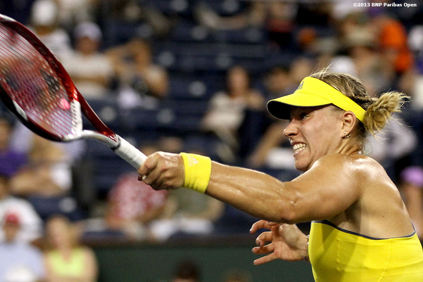 """Angelique Kerber returns a shot from Caroline Wozniacki in the semifinals Friday, March 15, 2013 at the BNP Paribas Open in Indian Wells, California."""