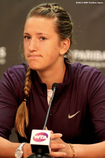 """Victoria Azarenka addresses the media after announcing her withdrawal from the tournament due to an ankle injury Thursday, March 14, 2013 at the BNP Paribas Open in Indian Wells, California."""