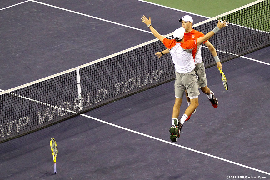 """Bob and Mike Bryan celebrate after defeating Santiago Gonzales and Scott Lipsky Thursday, March 14, 2013 at the BNP Paribas Open in Indian Wells, California."""
