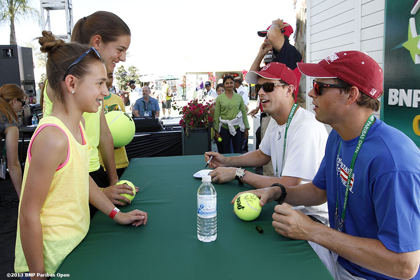 """Bob and Mike Bryan sign autographs Wednesday, March 13, 2013 at the BNP Paribas Open in Indian Wells, California."""