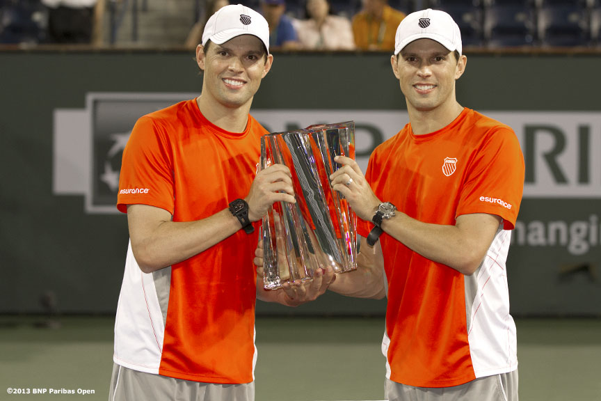 """Bob and Mike Bryan pose with the trophy after winning the men's doubles championship match Saturday, March 16, 2013 at the BNP Paribas Open in Indian Wells, California."""