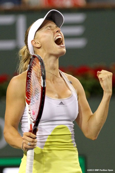 """Caroline Wozniacki reacts after defeating Angelique Kerber in the semifinals Friday, March 15, 2013 at the BNP Paribas Open in Indian Wells, California."""