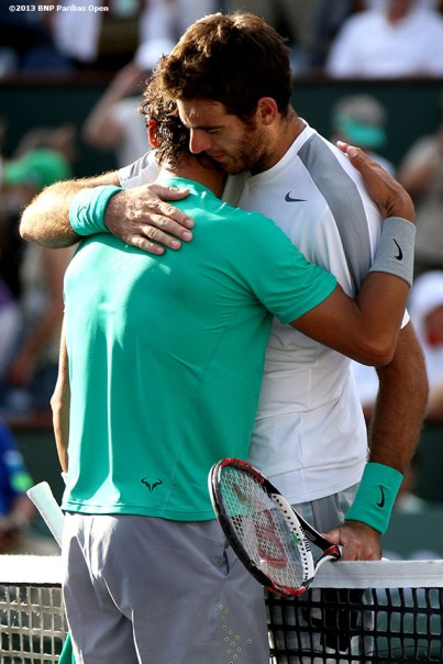 """Rafael Nadal and Juan Martin Del Potro congratulate each other after the championship match Sunday, March 18, 2013 at the BNP Paribas Open in Indian Wells, California."""