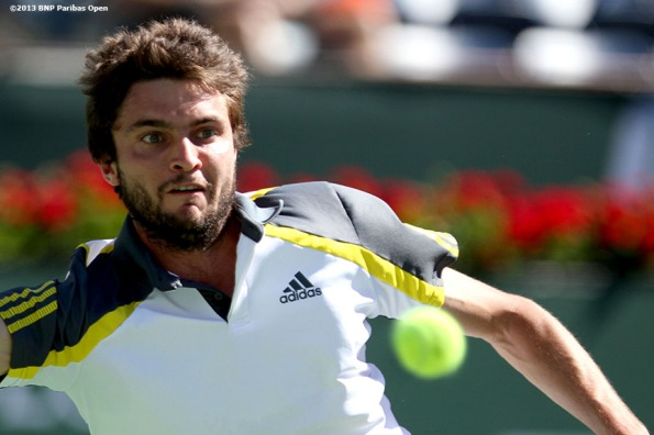 """Gilles Simon returns a shot from Kevin Anderson Wednesday, March 13, 2013 at the BNP Paribas Open in Indian Wells, California."""