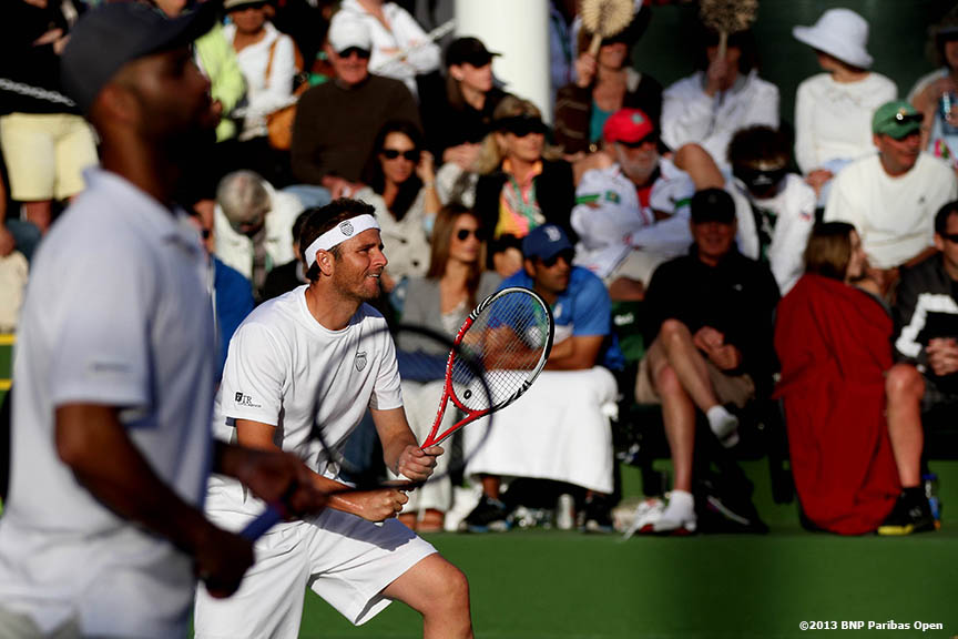 """Mardy Fish and James Blake play a point against David Marrero and Fernando Verdasco Saturday, March 9, 2013 at the BNP Paribas Open in Indian Wells, California."""