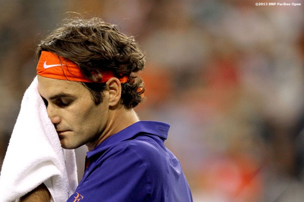 """Roger Federer wipes his face with a towel during his match against Rafael Nadal Thursday, March 14, 2013 at the BNP Paribas Open in Indian Wells, California."""