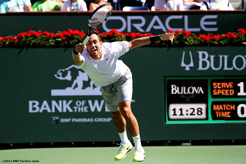 """Bobby Reynolds returns a serve during his match against Mardy Fish Sunday, March 10, 2013 at the BNP Paribas Open in Indian Wells, California."""