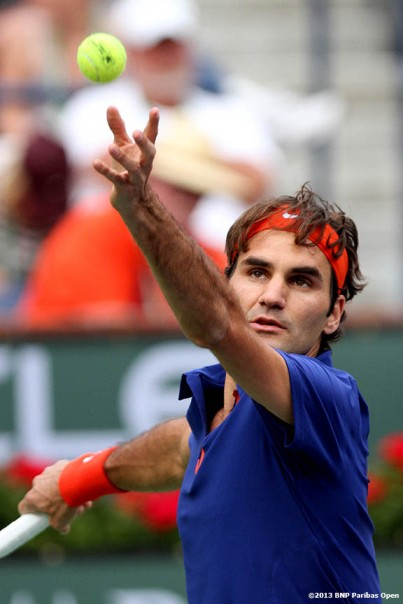 """Roger Federer serves during his match against Denis Istomin Saturday, March 9, 2013 at the BNP Paribas Open in Indian Wells, California."""