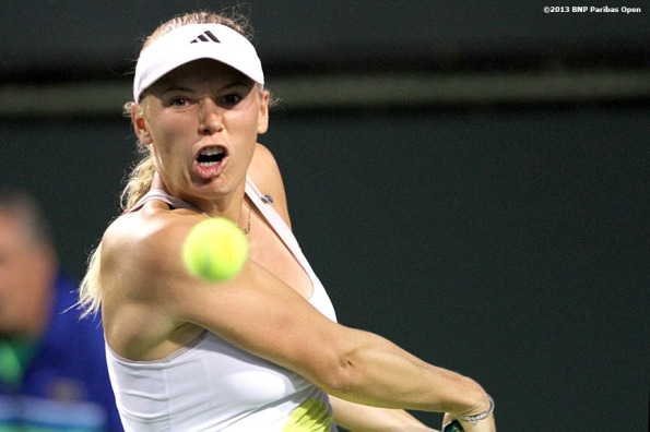"""Caroline Wozniacki hits a backhand during her match against Alize Cornet Saturday, March 9, 2013 at the BNP Paribas Open in Indian Wells, California."""