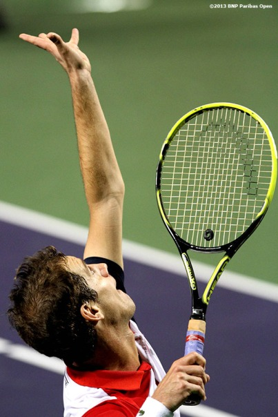 """Richard Gasquet serves during his match against Bernard Tomic Saturday, March 9, 2013 at the BNP Paribas Open in Indian Wells, California."""