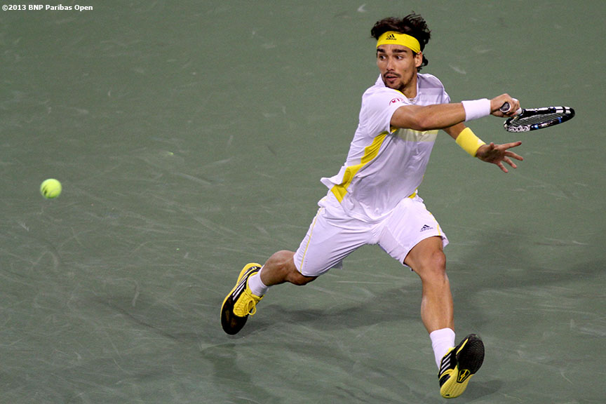 """Fabio Fognini returns a serve during his match against Novak Djokovic Sunday, March 10, 2013 at the BNP Paribas Open in Indian Wells, California."""