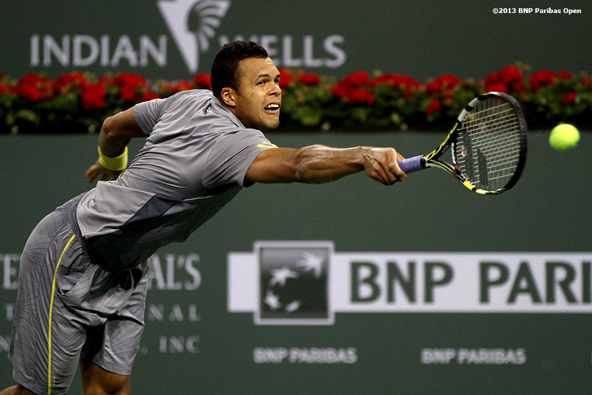 """Jo-Wilfried Tsonga returns a serve during his match against James Blake Sunday, March 10, 2013 at the BNP Paribas Open in Indian Wells, California."""