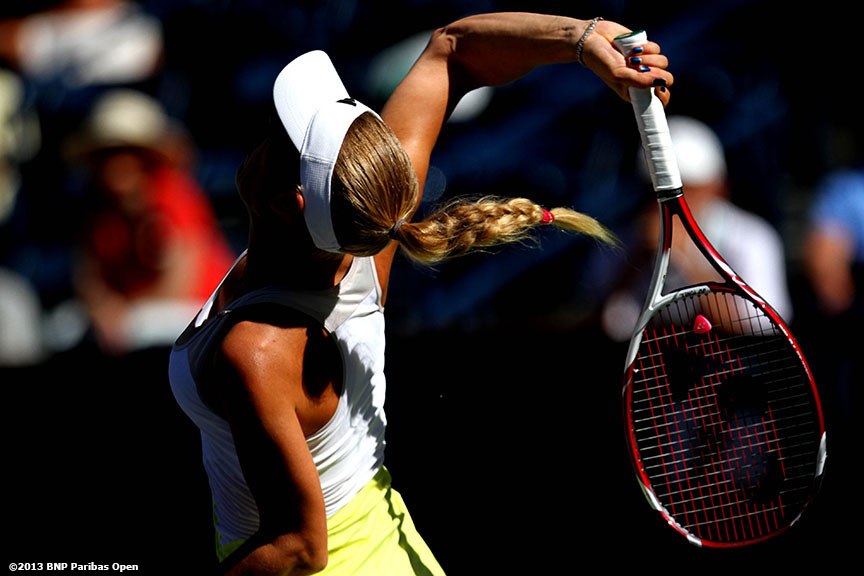 """Caroline Wozniacki serves during her match against Elena Vesnina Monday, March 11, 2013 at the BNP Paribas Open in Indian Wells, California."""