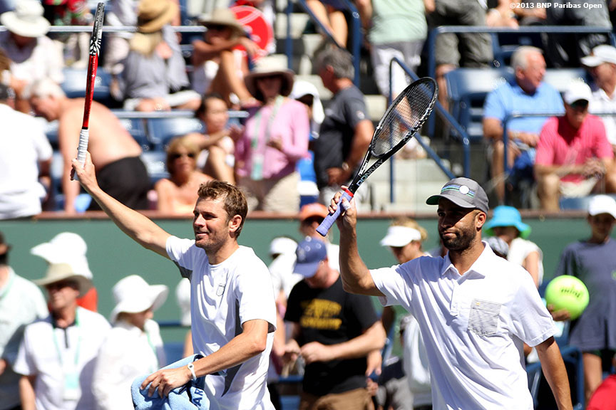 """Mardy Fish and James Blake wave to the crowd after defeating Milos Raonic and Feliciano Lopez Monday, March 11, 2013 at the BNP Paribas Open in Indian Wells, California."""