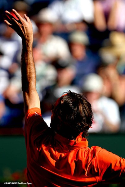 """Roger Federer serves during his match against Ivan Dodig Monday, March 11, 2013 at the BNP Paribas Open in Indian Wells, California."""