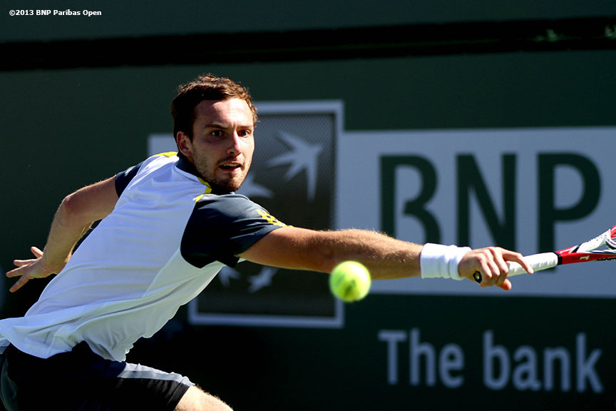 """Ernests Gulbis returns a shot during his match against Andreas Seppi Monday, March 11, 2013 at the BNP Paribas Open in Indian Wells, California."""