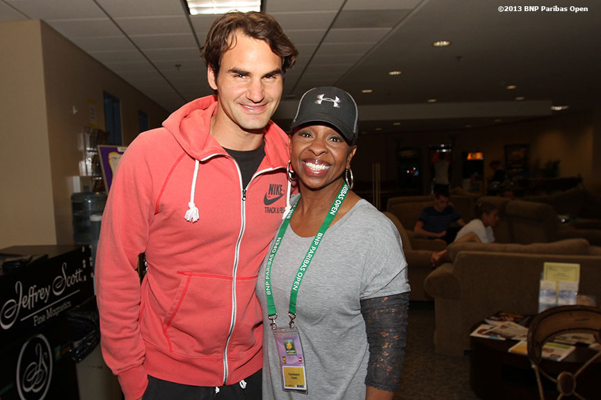 """Roger Federer poses for a photo with singer Gladys Knight Monday, March 11, 2013 at the BNP Paribas Open in Indian Wells, California."""