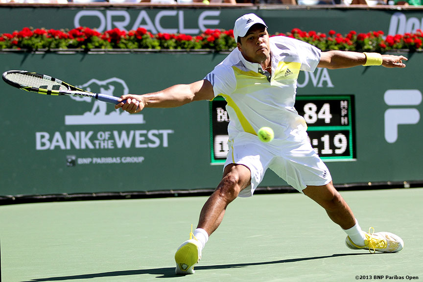 """Jo-Wilfried Tsonga returns a shot from Mardy Fish Tuesday, March 12, 2013 at the BNP Paribas Open in Indian Wells, California."""