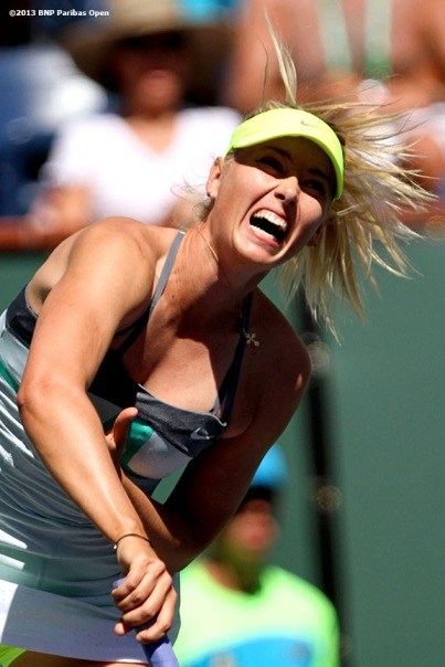 """Maria Sharapova serves during her match against Lara Arruabarrena-Vecino Tuesday, March 12, 2013 at the BNP Paribas Open in Indian Wells, California."""
