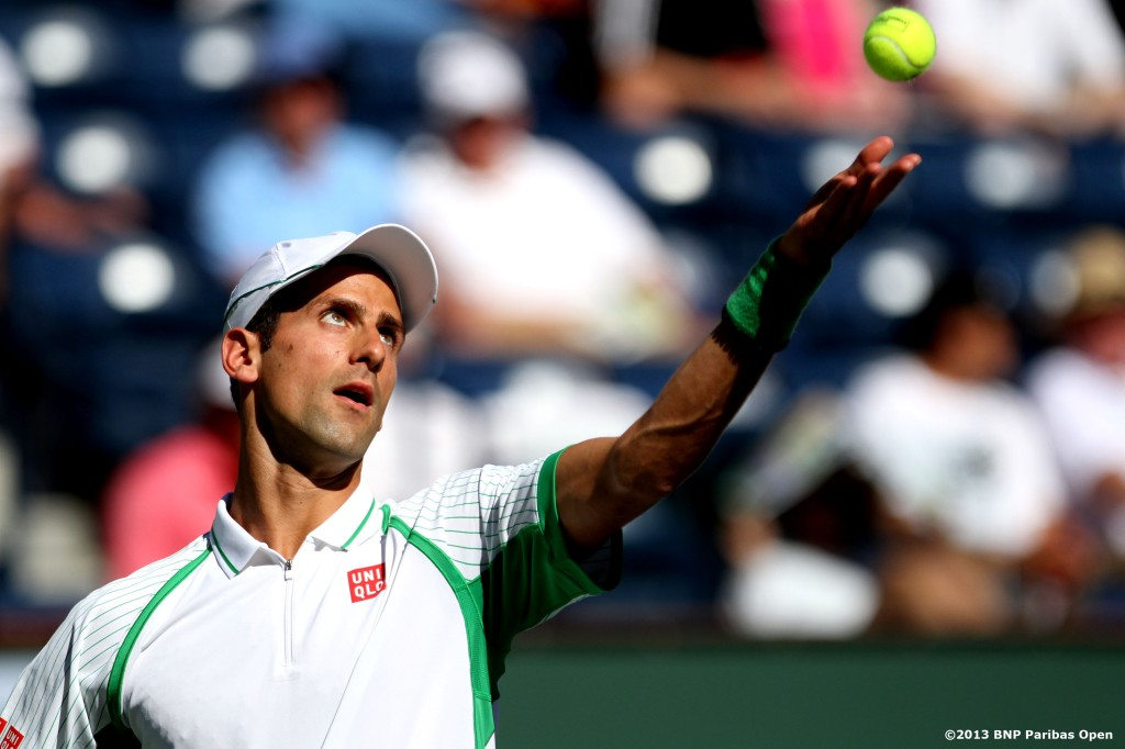 """Novak Djokovic serves during his match against Grigor Dimitrov Tuesday, March 12, 2013 at the BNP Paribas Open in Indian Wells, California."""