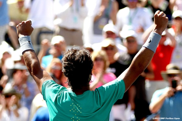"""Rafael Nadal celebrates after defeating Tomas Berdych and advancing to the finals Saturday, March 16, 2013 at the BNP Paribas Open in Indian Wells, California."""