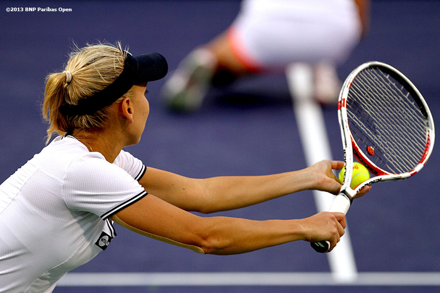 """Elena Vesnina serves during the women's doubles finals Saturday, March 16, 2013 at the BNP Paribas Open in Indian Wells, California."""