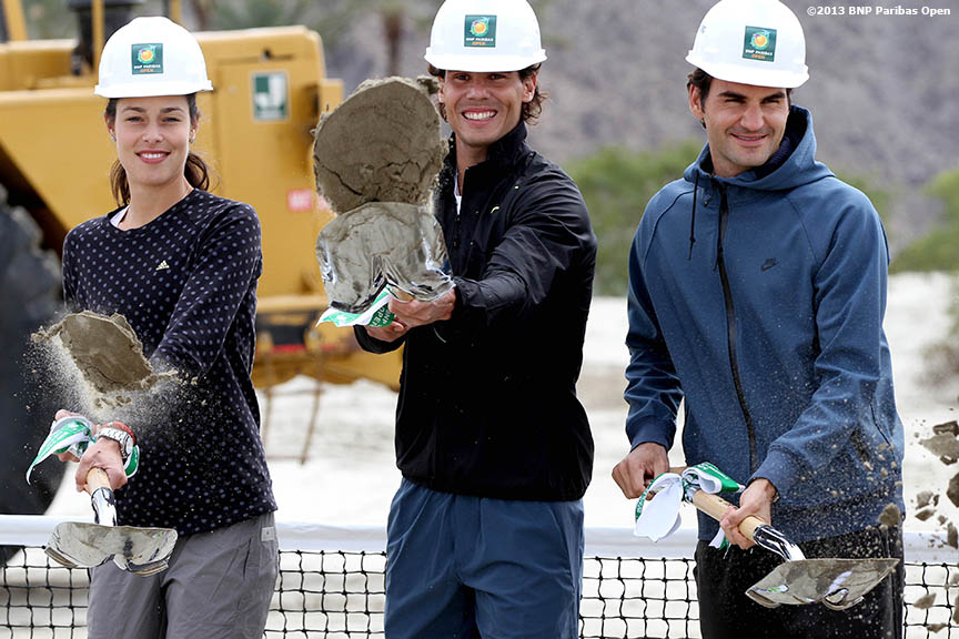 """Ana Ivanovic, Rafael Nadal, and Roger Federer shovel dirt Friday, March 8, 2013 during a groundbreaking ceremony for a new stadium set to be built at the Indian Wells Tennis Garden in Palm Springs, California."""