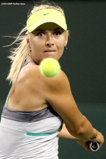 """Maria Sharapova hits a backhand during her semifinal match against Maria Kirilenko Friday, March 15, 2013 at the BNP Paribas Open in Indian Wells, California."""