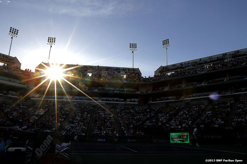 """The sun begins to set of Main Stadium at the Indian Wells Tennis Garden Friday, March 15, 2013 at the BNP Paribas Open in Indian Wells, California."""