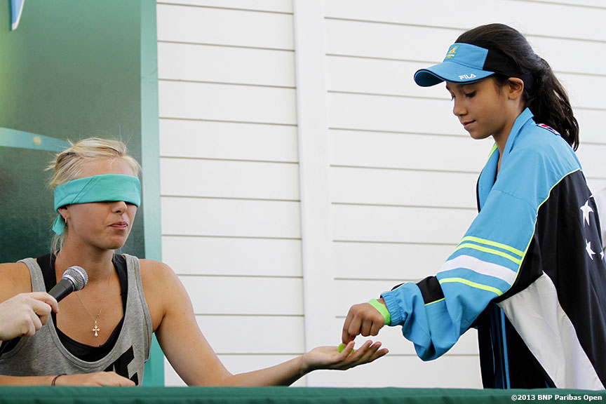 """Maria Sharapova participates in a blind taste test during a promotion for 'Sugarpova,' her line of gummy candies, at the Indian Wells Tennis Garden in Palm Springs, California on day one of the BNP Paribas Open Wednesday, March 6, 2013."""