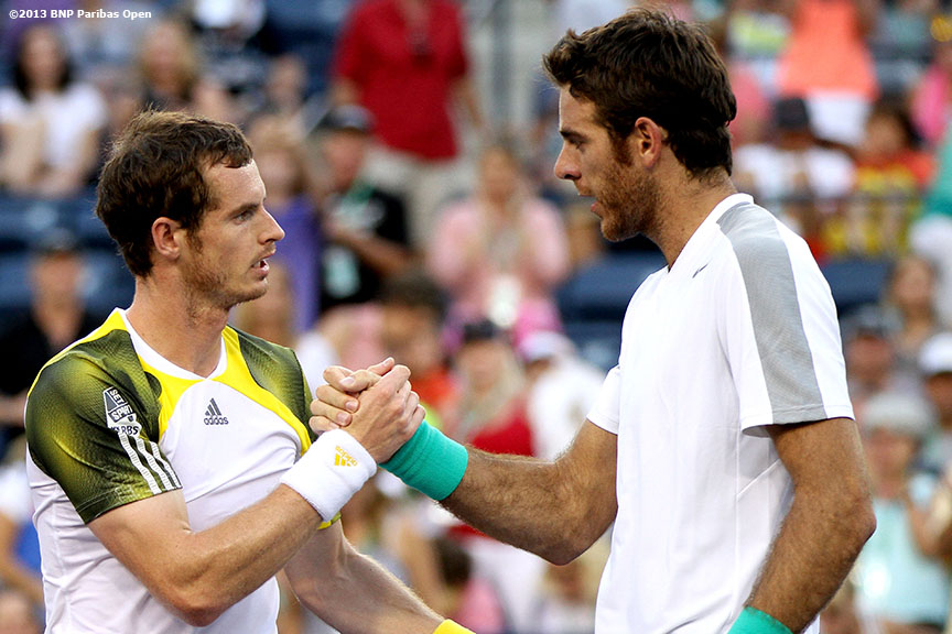 """Andy Murray and Juan Martin Del Potro shake hands after their quarterfinal match Friday, March 15, 2013 at the BNP Paribas Open in Indian Wells, California."""