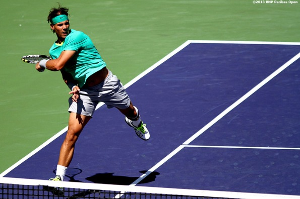 """Rafael Nadal hits a forehand during his semifinal match against Tomas Berdych Saturday, March 16, 2013 at the BNP Paribas Open in Indian Wells, California."""