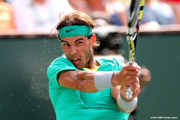 """Rafael Nadal hits a backhand against Juan Martin Del Potro during the championship match Sunday, March 18, 2013 at the BNP Paribas Open in Indian Wells, California."""