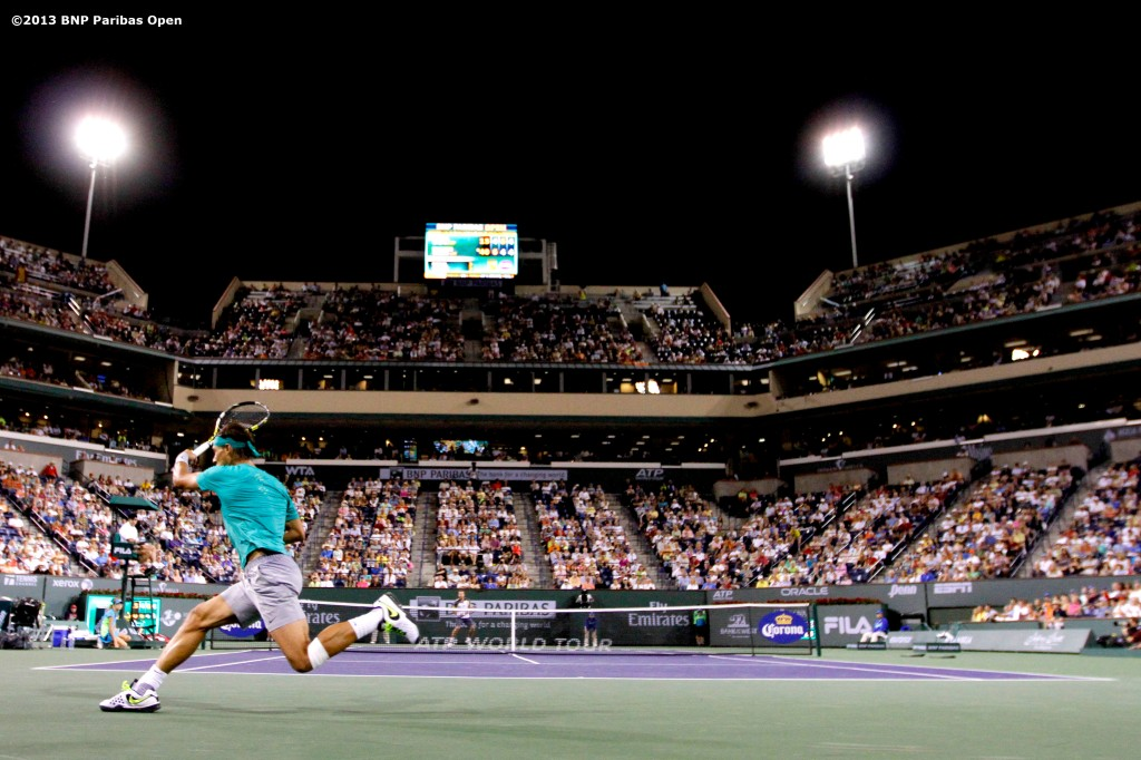 """Rafael Nadal returns a shot from Ernests Gulbis Wednesday, March 13, 2013 at the BNP Paribas Open in Indian Wells, California."""