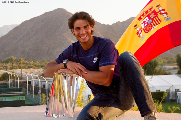 """Rafael Nadal poses for a championship photograph after winning the BNP Paribas Open Sunday, March 18, 2013 in Indian Wells, California."""