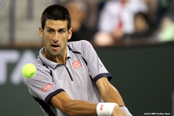 """Novak Djokovic returns a shot during his match against Sam Querrey Wednesday, March 13, 2013 at the BNP Paribas Open in Indian Wells, California."""