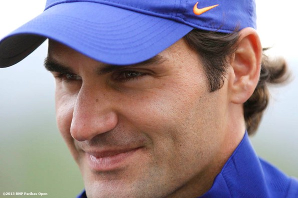 """Roger Federer addresses the media during a press conference Thursday, March 7, 2013 at the BNP Paribas Open at Indian Wells Tennis Garden in Indian Wells, California."""