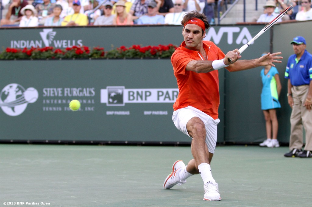 """Roger Federer hits a backhand during his match against Stanislas Wawrinka Wednesday, March 13, 2013 at the BNP Paribas Open in Indian Wells, California."""